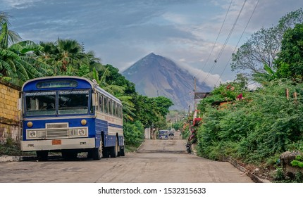 Ometepe Island, Nicaragua, Central America - May 5, 2017: Sunset in the streets of Ometepe Island with the Concepción volcano in the background, a bus in the front