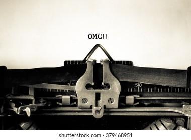 OMG - Oh My God message typed on vintage typewriter