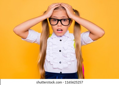 Omg! Summer holidays are finished! It's catastrophe! Dog ate my hometask! Close up portrait of sad upset terrified girl holding touching head with hands looking at camera isolated bright background