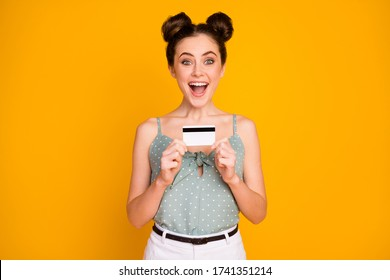 Omg i win golden debit card. Astonsihed crazy funny girl freelancer impressed by savings bank service income scream wow omg ear tank-top white isolated over bright shine color background