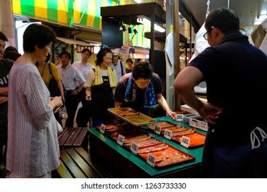 Omicho Market, Kanasawa, Japan - July 2018 : Local people waiting to buy grilled eel (unagi) at the famous fish market.
