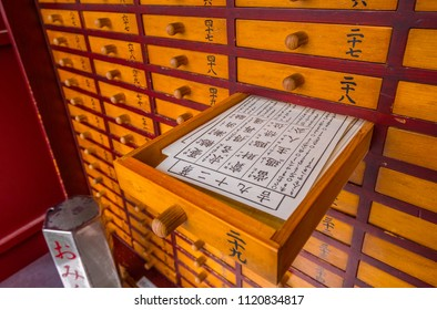 Omikuji - random fortune papers at a Buddhist temple or Shinto Shrine - TOKYO / JAPAN - JUNE 12, 2018