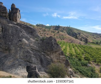 Ominous sandstone rock outcroppings in a desert like atmosphere at the Peshastin Pinnacles State Park in Chelan County Washington