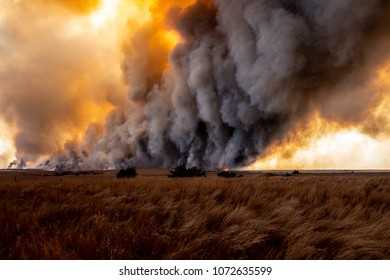 The ominous smoke plume of the Rhea wildfire as it burns across grasslands in western Oklahoma