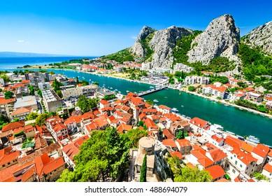 Omis, Croatia. Dalmatia Coast panorama with emerald-green Cetina River, Croatian travel landmark at Adriatic Sea.