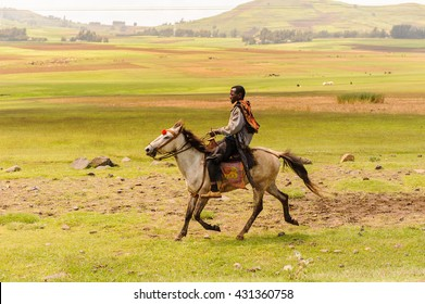 OMO, ETHIOPIA - SEPTEMBER 19, 2011: Unidentified Ethiopian man rides a horse in open field. People in Ethiopia suffer of poverty due to the unstable situation