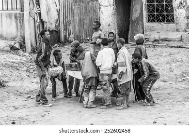 OMO, ETHIOPIA - SEPTEMBER 21, 2011: Unidentified Ethiopian children play in the street. People in Ethiopia suffer of poverty due to the unstable situation