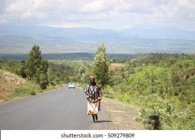 OMO VALLEY, ETHIOPIA - CIRCA NOVEMBER 2015: Konso woman walking up the hill.