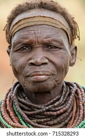 Omo Valley, Ethiopia, December 26, 2010: Old Nyangatom woman posing in her village. The Nyangatom are an ethnic group in the Omo Valley.The necklaces of this primitive tribe are very special.