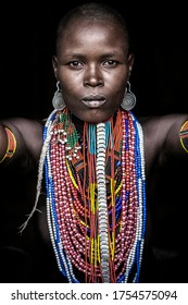 Omo Valley, Ethiopia- March 19 2019: Closeup portrait of a woman from the Arbore tribe, Omo Valley, Ethiopia.