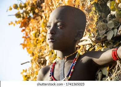 Omo Valley, Ethiopia - March 20 2019: Portrait of an african boy from the Karo tribe, Omo valley, Ethiopia