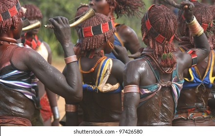 In the Omo Valley of Ethiopia, women of the Hamer tribe dance at a local wedding