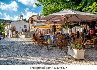 OMODOS, CYPRUS - OCTOBER 04, 2015: People sitting at an outdoors cafe in Omodos village, Limassol District
