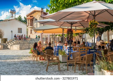 OMODOS, CYPRUS - OCTOBER 4, 2015: Street cafe's with tourists on OCTOBER 4 in Omodos village, Limassol District.