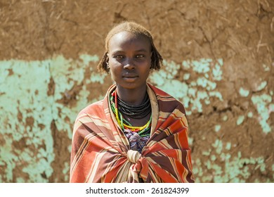 OMORATO, LOWER OMO VALLEY, ETHIOPIA - JANUARY 31, 2012:  Portrait of unidentified Dassanech girl. Omorato one of the poorest places in Ethiopia.