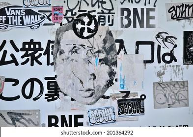 OMOTESANDO, TOKYO - APRIL 12, 2013:  Artistic sticker or street art in Shibuya area, downtown Tokyo, Japan.
