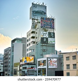 OMOTESANDO, TOKYO - JULY 26, 2014: Buildings with a many billboards. Photographed from the crossing of Omotesando street and Meiji Dori street, near Harajuku area in downtown Tokyo.