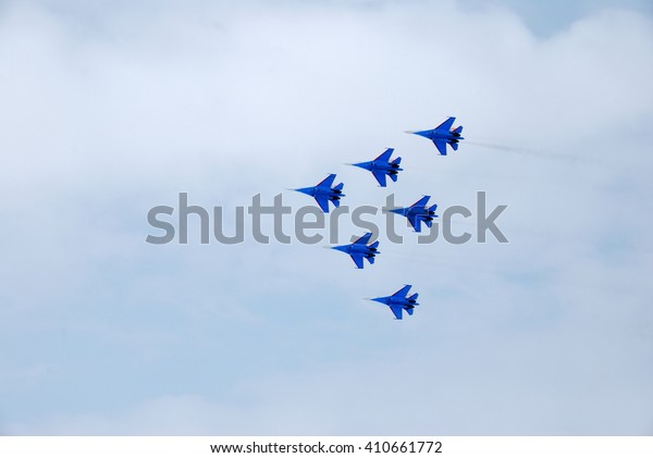 Omsk Russia - 19 March 2016: Performance of aerobatic team Russian Knights at the air show