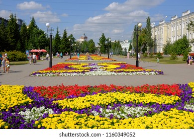 """Omsk, Russia - August 7, 2018: City exhibition of green building, floriculture and gardening """"Flora-2018"""". Pervomaisky Square"""