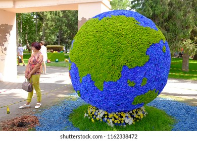 """Omsk, Russia - August 7, 2018: City exhibition of green building, floriculture and gardening """"Flora-2018"""". Entrance to the Exhibition Square."""