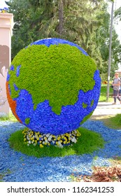 """Omsk, Russia - August 7, 2018: City exhibition of green building, floriculture and gardening """"Flora-2018"""". Exhibition Square. Model of the globe, covered with flowers"""