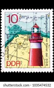 OMSK, RUSSIA - FEBRUARY 28, 2018: a postage stamp printed in East Germany shows the geographical location of the lighthouse in 1878, around 1975, close-up, isolated