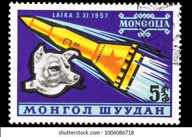 OMSK, RUSSIA - JANUARY 20, 2018: A stamp printed in the Mongolia, shows the soviet rocket and dog Laika, circa 1957, close-up, isolated