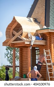 Omsk, Russia - July 05, 2014: building of the wodden chapel, builders work