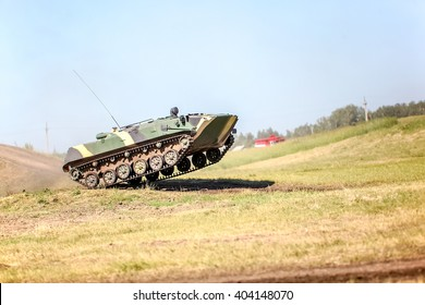 Omsk, Russia - July 07, 2011: International exhibition of high-tech equipment and weapons, tank on maneuvers, jump