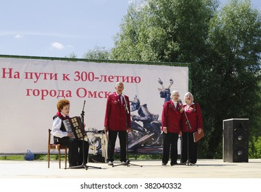 Omsk, Russia - June 12, 2015: vocal-instrumental ensemble of veterans performs on outdoor stage