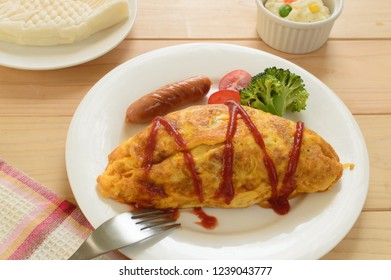 Omurice is an example of yōshoku consisting of an omelette made with fried rice and usually topped with ketchup or demi glace sauce.