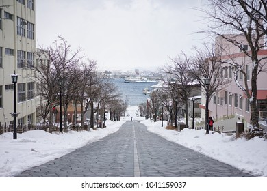 on 12 February 2018 at Hachiman-zaka Slope in Motomachi where is a well-known tourist site to see beautiful scenery in Hakodate, Hokkaido, Japan