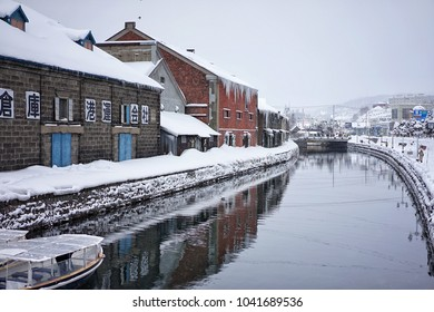 On 14 February 2018 at Otaru Canal, Hokkaido, Japan in the winter that is a popular tourist destination for Japanese and foreign visitors to see the romantic scene image with snow