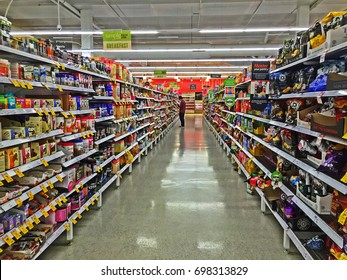 On 5th May 2016, a male customer choosing food product from shelves full of various products between aisles in Coles Supermarket, Footscray, Melbourne, VIC Australia