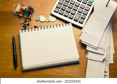 On the accountant desk with empty page of spiral notebook for place text