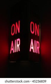 On Air studio sign illuminated.  Vertical aspect with dual lights and red glow.