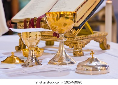 on the altar of the pyx and chalice mass they contain wine and hosts, blood and body of Christ