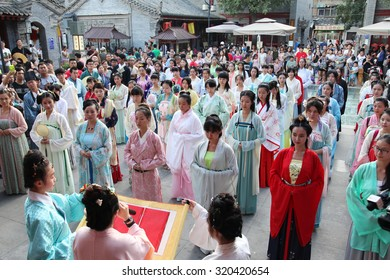 On August, 2015, 20, xian, China, wearing hanfu Oriental woman in the worship of the legendary vega, attracting tourists. The day is valentine's day in ancient China: Chinese valentine's day.