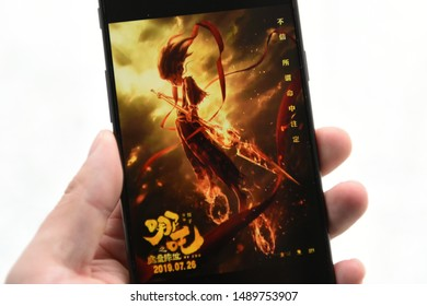 """On August 28, 2019, in Anhui Province, China, a user's mobile phone showed a poster of the movie """"Ne Zha"""". Ne Zha is a 2019 Chinese three-dimensional animated comedy fantasy movie. (哪吒: Ne Zha)"""