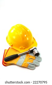 on a background is yellow helmet, work gloves, tools