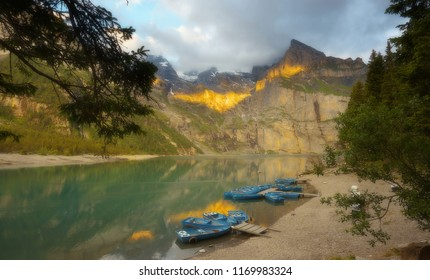 On the bank of a lake of Oeschinensee during a sunset, version with a soft filter, Switzerland
