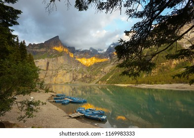 On the bank of a lake of Oeschinensee during a sunset, Switzerland