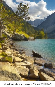 On the bank of a mountain lake Lac de Gaube, Pyrenees Occidentales, France