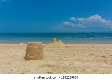On the beach near the sea there is a sand tower