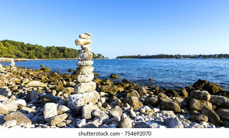 On the beach stones are stacked.