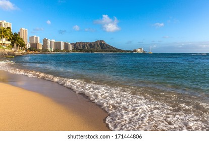 On the beach of Waikiki with Diamond Head Volcano in the background
