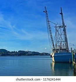 On a beautiful day, a fishing boat is docked, North Carolina