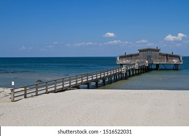 On the beautiful sandy beach of the swanky Swedish seaside resort of Bastad a jetty with a characteristic bath house. which is built on wooden stilts