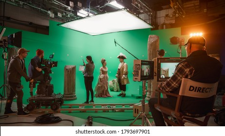 On Big Film Studio Professional Crew Shooting History Costume Drama Movie. On Set: Director Controls Cameraman Shooting Green Screen Scene with Two Actors Talented Wearing Renaissance Clothes Talking