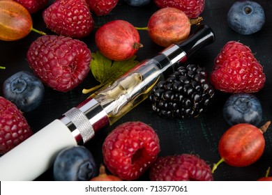 on a black background, a set of ripe garden berries, for an electronic cigarette taste